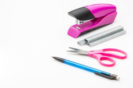 Stapler, staples, scissors and pencil on white background.