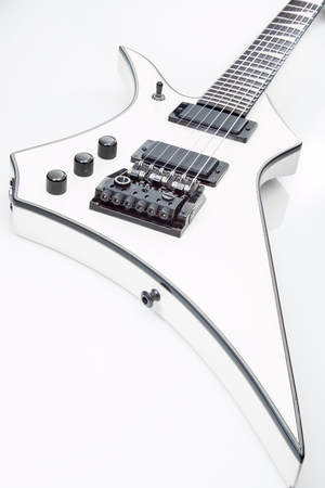 White electric guitar on a white background.