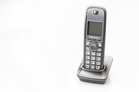 touchtone: Portable telephone and base on a white background.