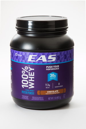 Pensacola, FL - June 4, 2017: EAS 100% Whey protein powder in Chocolate flavor is used for supplementation of protein.