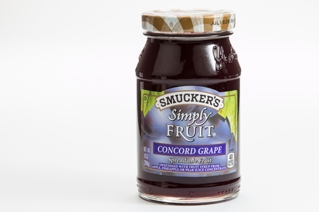 Pensacola, FL - June 4, 2017: Smuckers brand Simply Fruit Grape Jelly is a popular breakfast food.