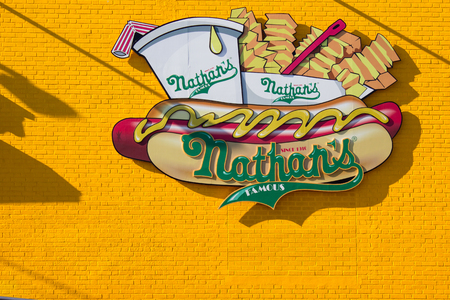 BROOKLYN, NY - NOVEMBER 21: A sign for Nathans Famous, an iconic restaurant on Coney Island in Brooklyn, NY, November 21, 2012.