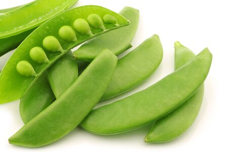 snaps: bunch of sugar snaps with one opened pod with peas visible on a white background