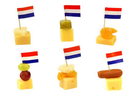 Dutch cheese snacks with Dutch flag toothpicks on a white background  photo