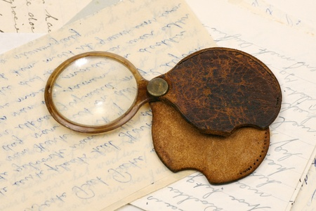 tarnished: a magnifying glass on some old letters