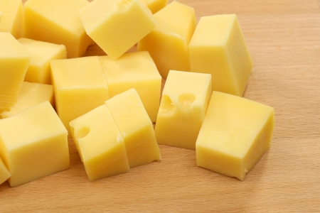 blocks of Dutch cheese on a wooden tray 版權商用圖片 - 14900099