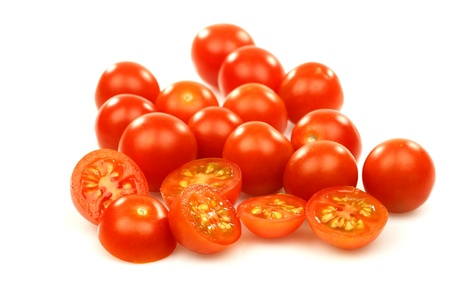 fresh whole and sliced cherry tomatoes on a white background  photo