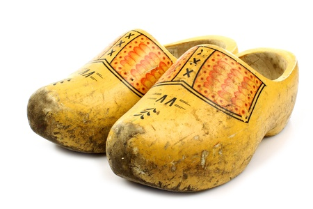 klompen: pair of traditional Dutch yellow wooden shoes on a white background