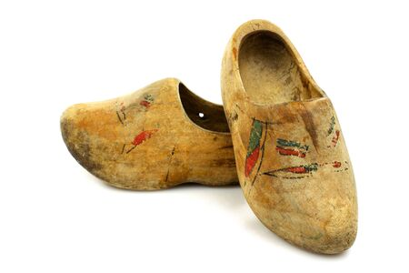 klompen: pair of very old traditional Dutch decorated wooden shoes on a white background  Stock Photo