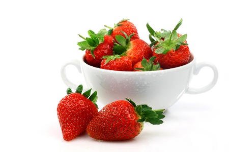 fresh strawberries in a white ceramic bowl on a white background  photo