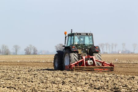 leveling: land leveling on a field in holland  Stock Photo