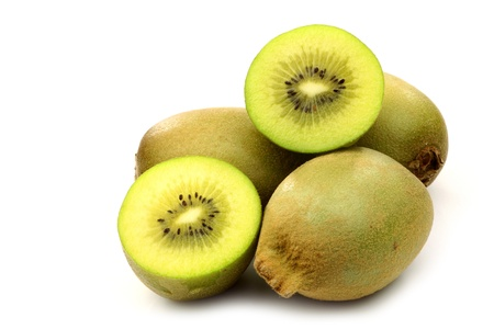 fresh kiwi fruit and two halves on a white background  photo
