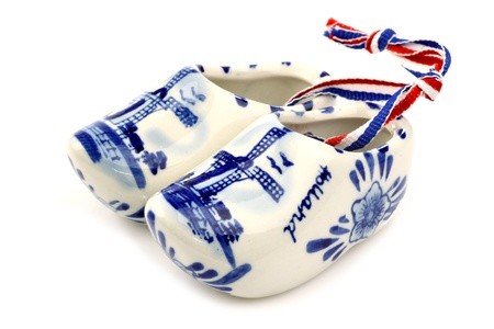 Delft blue ceramic  wooden shoes  from Holland on a white background  photo