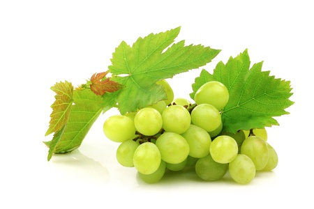 white grapes and some foliage on a white background  photo