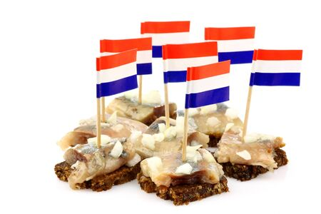 Fresh herring  Dutch  Hollandse Nieuwe   with chopped onions on rye bread on a white background  photo