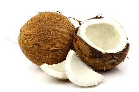 two fresh coconuts and one opened on a white background
