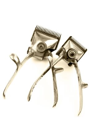 trimmers: vintage metal hair trimmers on a white background