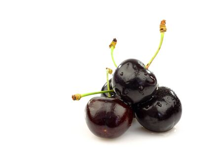 bunch of fresh black sweet cherries on a white background  photo