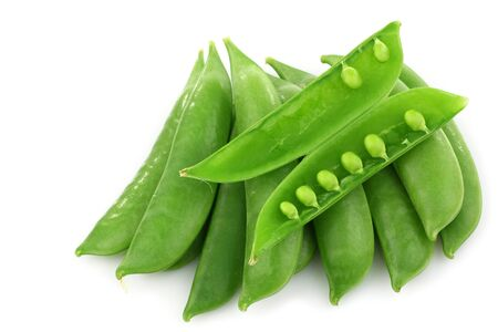 bunch of sugar snaps with one opened pod with peas visible  photo