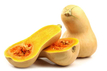 bottle shaped butternut pumpkin and two halves on a white background  photo