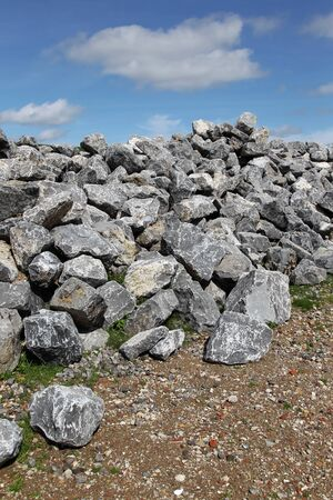 dikes: bunch basalt rocks ready for use for the strengthening of the dikes in Holland  Stock Photo