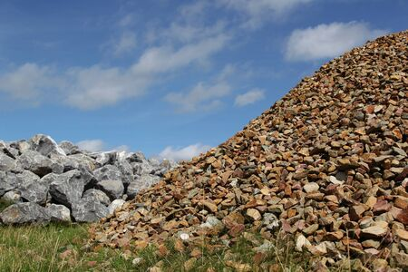 dikes: bunch basalt rocks and gravel ready for use for the strengthening of the dikes in Holland