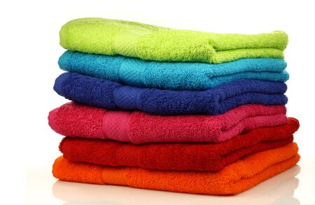 stacked colorful towels on a white background  photo