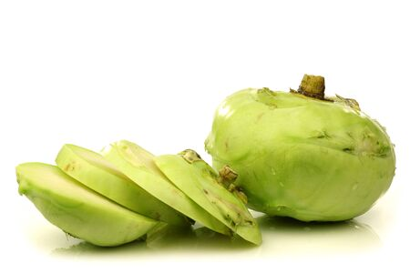 one whole and one cut kohlrabi on a white background Stock Photo - 15003550