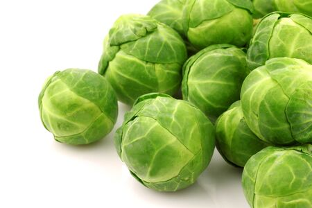 harvests: Freshly harvested Brussel sprouts on a white background