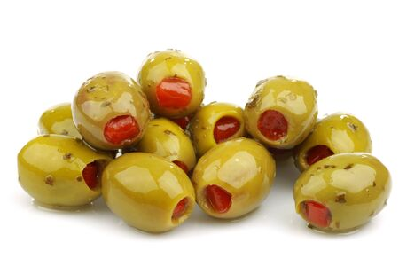 pimento: bunch of stuffed green olives on a white background  Stock Photo