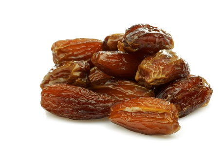 dates fruit: bunch of date fruit on a white background