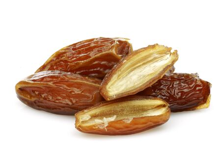 date fruit and a cut one on a white background  Stock Photo - 15006220