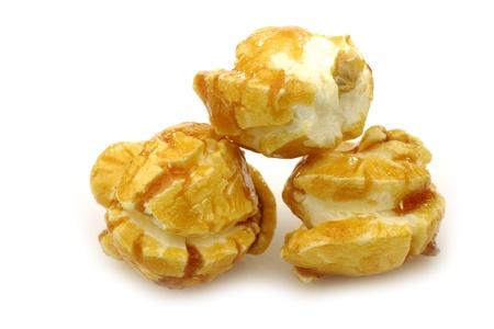 caramel: pieces of caramel popcorn on a white background  Stock Photo
