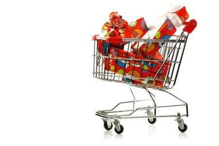 shopping cart with colorful wrapped  Sinterklaas presents on a white background  Stock Photo - 15048944