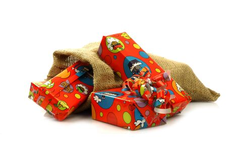 colorful  Sinterklaas  presents in a burlap sack  on a white background Stock Photo - 15048961