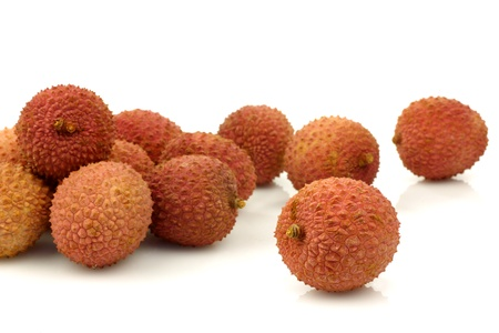 lychees: bunch of fresh lychees on a white background  Stock Photo