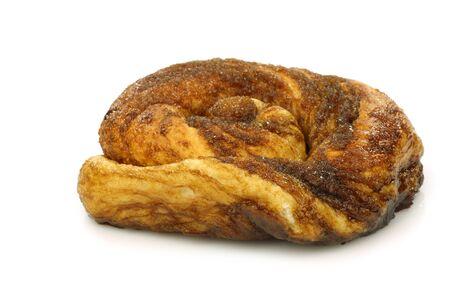 bolus: traditional Dutch cinnamon and sugar rolls called  Zeeuwse bolus  on a white background