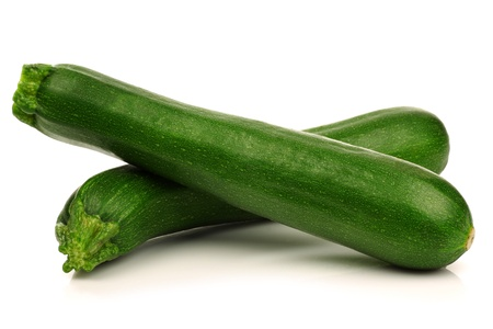 zucchini vegetable: two fresh zucchini s  Cucurbita pepo  on a white background  Stock Photo