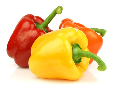 capsicum: red, orange and yellow paprika capsicum  on a white background  Stock Photo