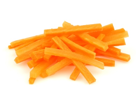 winter carrot cut in julienne on a white background