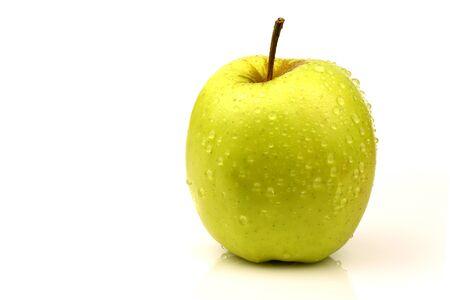 golden apple: fresh  Golden Delicious  apple on a white background