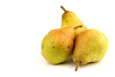 Doyenne du Comice pears on a white background  photo