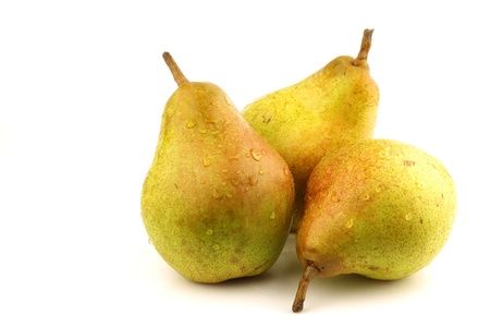 Doyenne du Comice pears on a white background