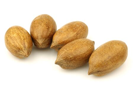 anti oxidants: tasty pecan nuts on a white background
