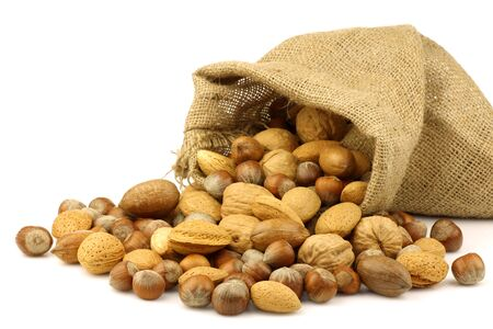burlap sack: assorted nuts coming out of a burlap sack