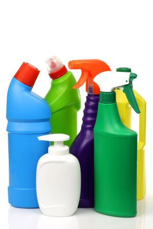 plastic cleaning bottles in various colors on a white background  photo