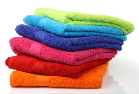 towels bath: colorful stacked bathroom towels on a white background
