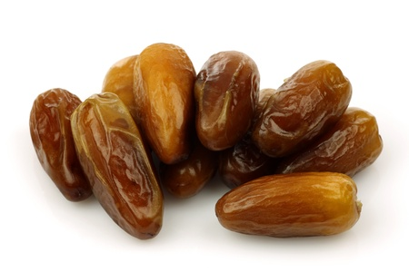 bunch of dried dates on a white background  photo