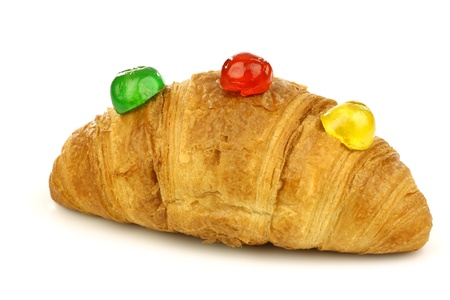 conserved: freshly baked croissant bread with colorful conserved fruits on a white background