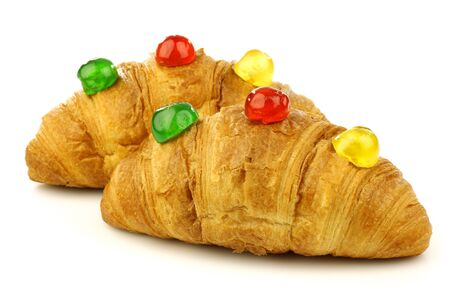 conserved: freshly baked croissants bread with colorful conserved fruits on a white background